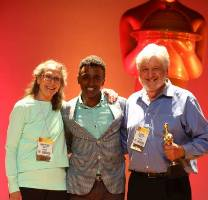 Marcus Samuelsson presents the Sofi Gold Award for Outstanding Soup, Stew, Chili or Bean to Sarabeth's Kitchen at the SFA 2013 Summer Fancy Food Show at the Javits Center in NYC.